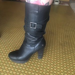 Black leather women's Ugg boots.